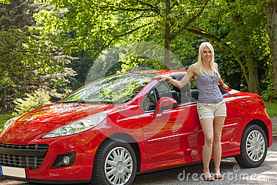 A young girl with a red car