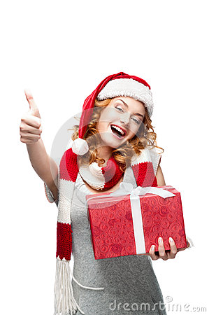 Young girl with red gift showing thumbs-up