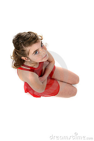 Young girl in red leotard kneeling