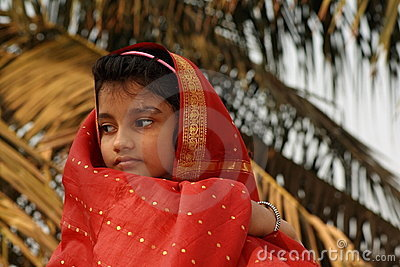 Young girl in red sari