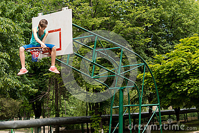 Young girl replacing a basketball net