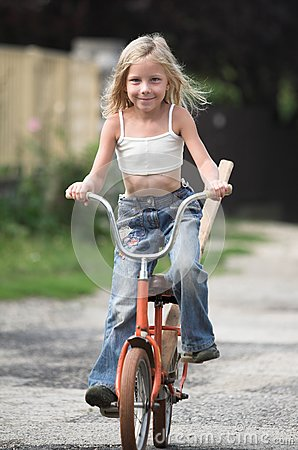 Young girl rides her bicylce