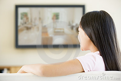 Young girl in room with flat screen television