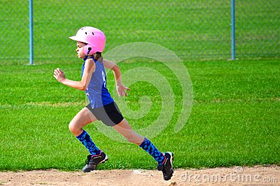 Young Girl Running Bases in Softball