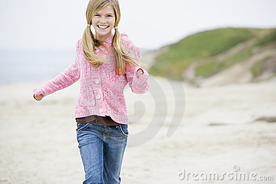 Young girl running at beach