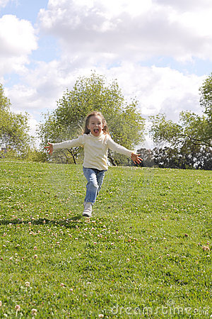 Free Young Girl Running On A Lawn At Park Stock Images - 10939084