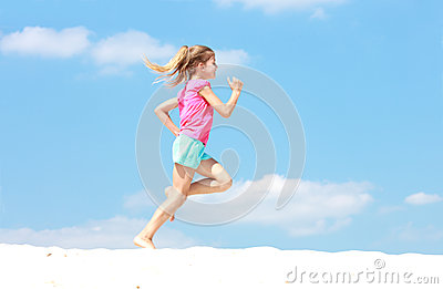 Young girl running in profile