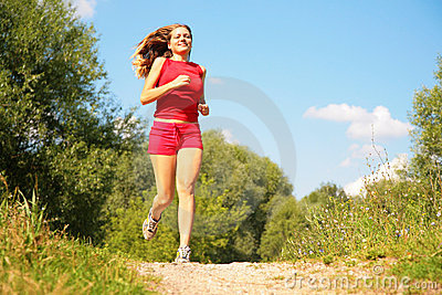 Young girl runs in forest