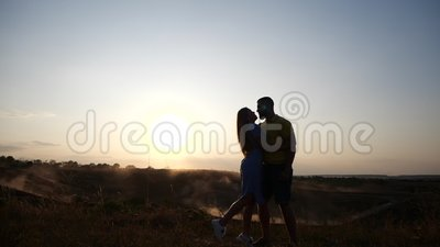 Young girl runs in slow motion toward a bearded young man and kisses him. Couple in rural landscape at breathtaking. Young girl runs toward a bearded young man stock video