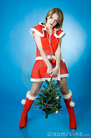Young girl in Santa Claus clothes