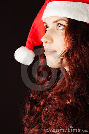 Young girl in Santa Claus hat