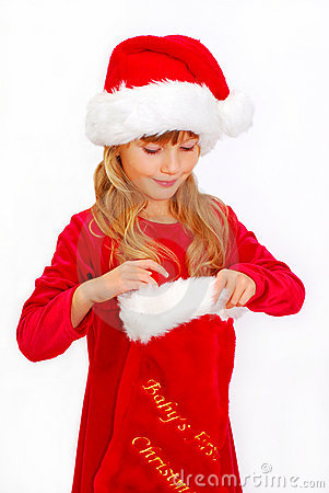 Young girl in santa cloth with christmas sock