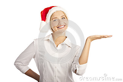 Young girl in a Santa hat in the studio on a white