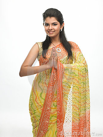 Young girl in sari in a welcome posture