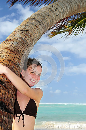 Young girl with palm tree