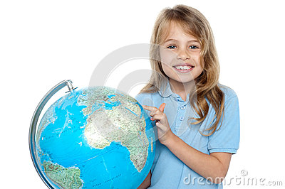 Young girl selecting holiday destination over globe