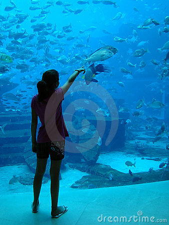 Young Girl showing fish