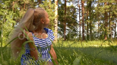 Young Girl Sit Meadow Forest Glade Grass Lawn stock video