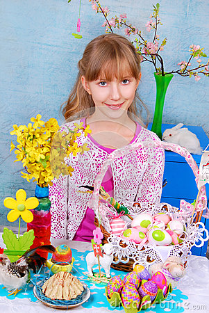 Young girl  sitting at the Easter table