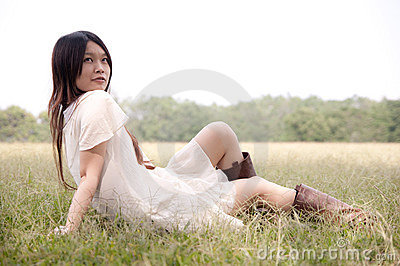 Young girl sitting on the grass