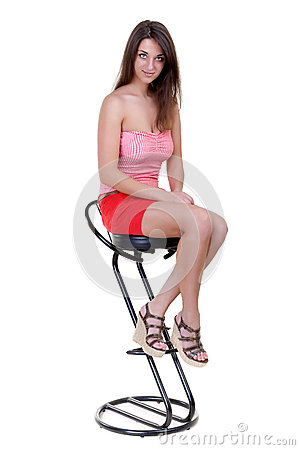 Free Young Girl Sitting On A Bar Stool Royalty Free Stock Image - 24933656