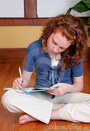 Free Young Girl Sitting On The Floor Writing Stock Photo - 5308210