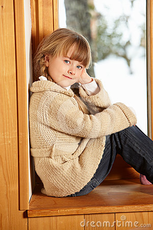 Free Young Girl Sitting On Window Ledge Stock Photo - 24374170