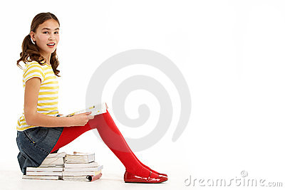 Young Girl Sitting On Pile Of Books