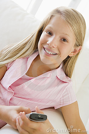 Young Girl Sitting On A Sofa Texting