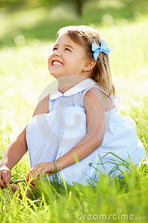 Young Girl Sitting In Summer Field