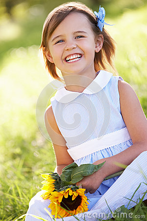 Young Girl Sitting In Summer Field Stock Images - Image: 26106404