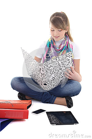 Young girl sitting with tablet pc and phone