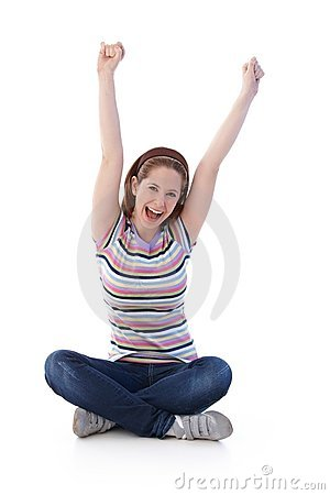 Young girl sitting in tailor seat shouting happily