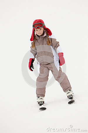 Young Girl Skiing Down Slope On Holiday