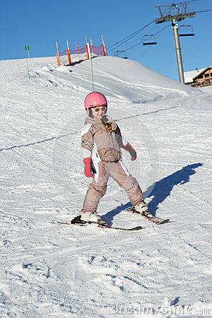 Young Girl Skiing Down Slope Whilst On Holiday