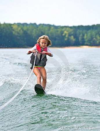 Young Girl Slalom Skiing
