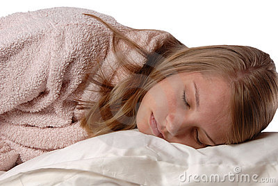 Young girl sleeping on a soft white pillow