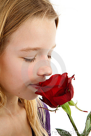 Free Young Girl Smelling A Red Rose Royalty Free Stock Images - 18217519