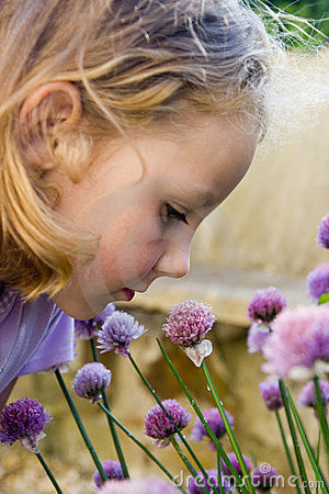 Free Young Girl Smelling Purple Flowers. Royalty Free Stock Image - 930026