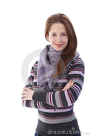 Young girl smiling arms crossed