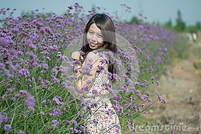 Young girl smiling in the flowers