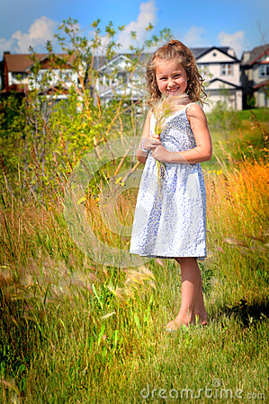 Young girl smiling in grassy scenery