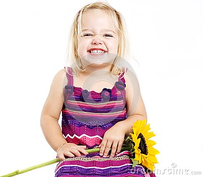 Young girl smiling with sunflower
