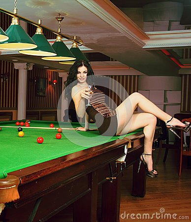 Young girl in snooker bar