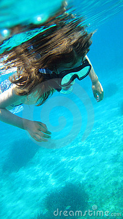 Young girl snorkeling