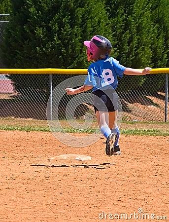 Young Girl Softball Player Running
