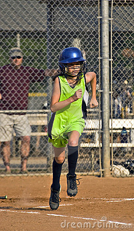 Young Girl Softball Player Running to First Base