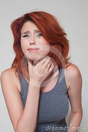 Young girl with sore throat