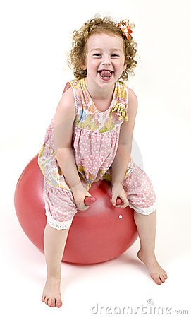Young girl on a space hopper