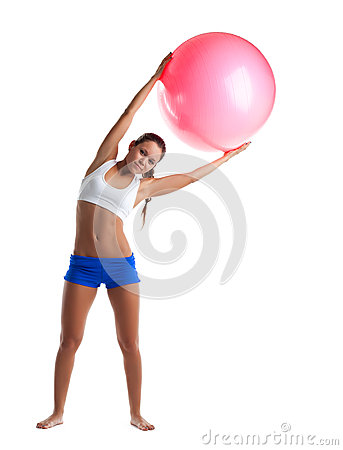 Young girl stand with fitness ball isolated